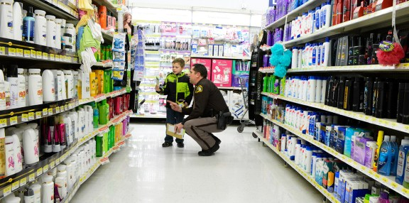 Mason County Sheriff Chief Deputy Steve Hansen helps find that special gift.