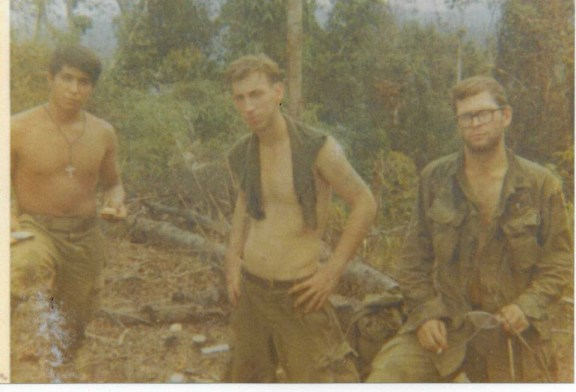 Bob Taylor, far right, with two other company members during his time in Vietnam.