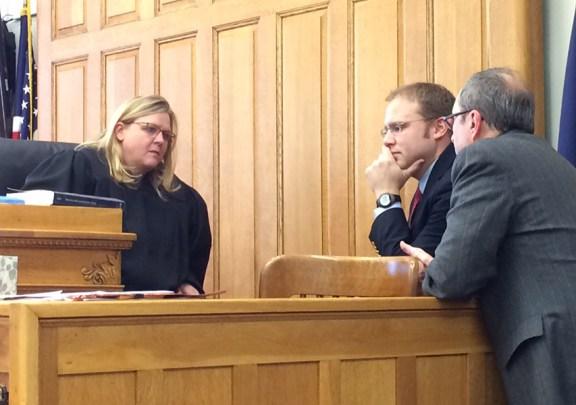 Judge Sniegowski confers with prosecutor Paul Spaniola, right, and defense attorney David Glancy.