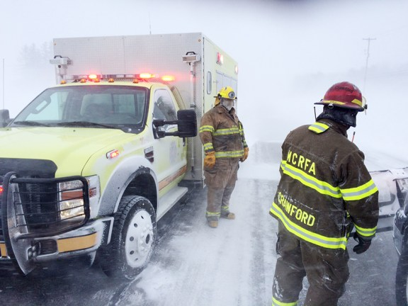 Custer Fire Dept. personnel stop traffic along U.S. 10.