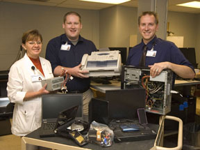 Information Services staff members display some of the 10 tons of electronic equipment recycled by Spectrum Health Ludington Hospital employees and community residents last fall. From left, Cathy Beckett, Will Hagerty and Chip Bowden.