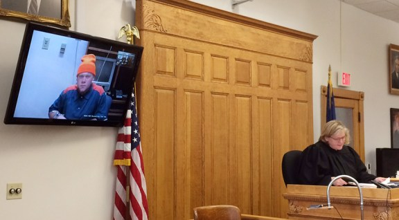 Malone appears in court via teleconference.