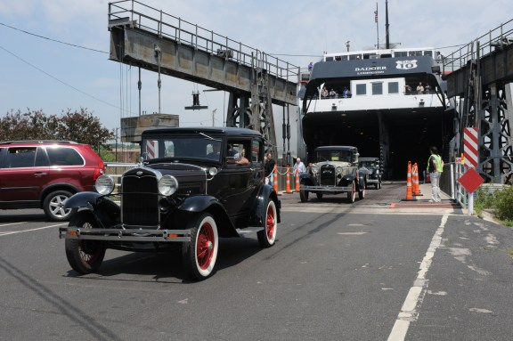 Model A's, that once roamed highways like U.S. 10, drive off the SS Badger. MCP File Photo.