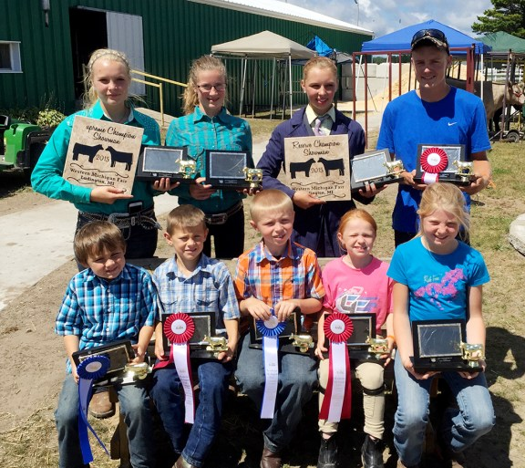 Beef showmanship Front row, from left: Open youth 5- to 6-year-olds: Cyric Rees, first place; Milo Shoup, second; 7-8: Brogan Quillan, first; Payton Haynes, second; 9-10: Briana Crawford. Second row: first; Olivia Wilkosz, absent. Second row: Paige Whitaker, first place intermediate, supreme champion showman; Morgan Ahlfeld, second intermediate showman; Faith Whitaker, reserve champion, showman first place junior; Matthew Lammi, second junior.