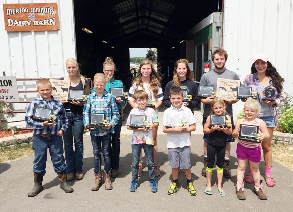 Dairy showmanship. Front row, from left: Logan Stakenas, first place beginners; Brianna Crawford, second place, beginners; Bryce Thurow, first place open youth ages 7-8; Dylan Bailey, second place open youth 7-8; Aiden Wood, first place open youth 5-6; Isabel Babbin, second place open youth 5-6. Second row, from left: Paige Whitaker, first place intermediate, reserve champion showman; Morgan Ahlfeld, second place intermediate; Leta Larsen, first place junior; Brooke Thurow, second place junior; Trent Thurow, first place senior showmanship; Lindsay Larsen, second place senior, best dairy showman of the day.