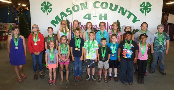 4-H exhibits. Ages 12 and under. First row, from left: Payton Haynes, Autumn Weiton, Clayton Shoup, Keenen Kelley, Milo Shoup, Brandon Austin, Christian Cheney, Frances Cheney. Second row, from left: Haley Story, McKenzie Nielsen, Kendra Gilchrist, Anna Campbell, Reagan Wiese, Anna Roberson, Addie Nelson, Rachel Faust, Allison Diehm, Jessica Gerbers, Justin Gerbers.