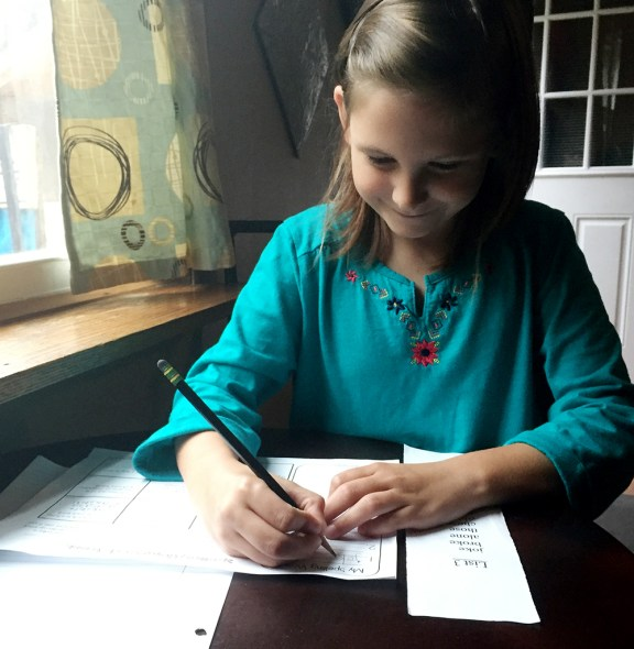 Chelsea Hamilton spends time on her afternoon homework.