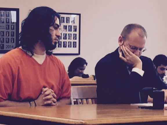 Jordon Harris with his attorney, David Glancy.
