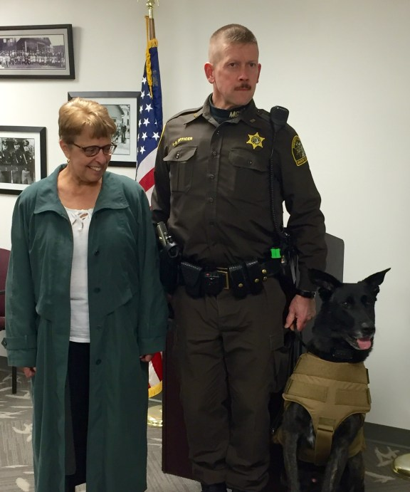 Carol Broderick, left, stands with Cash and his handler, Dep. Ken Baum.