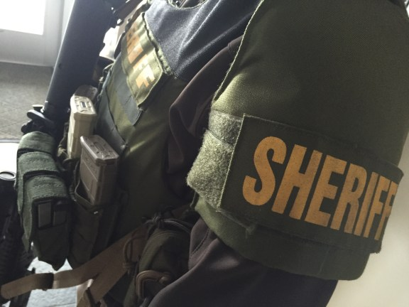 A sheriff's deputies guards the entrance to Mason County Reformed Church.