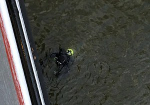 A diver was called in to clear the Badger's intakes. Photo by Erika Minnberg.