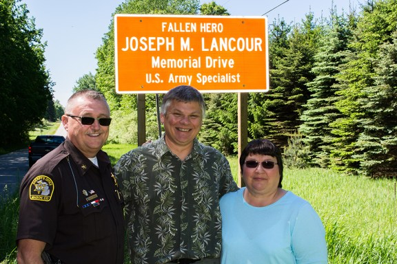 Sheriff Cole, left, with Rob and Sue Lancour.