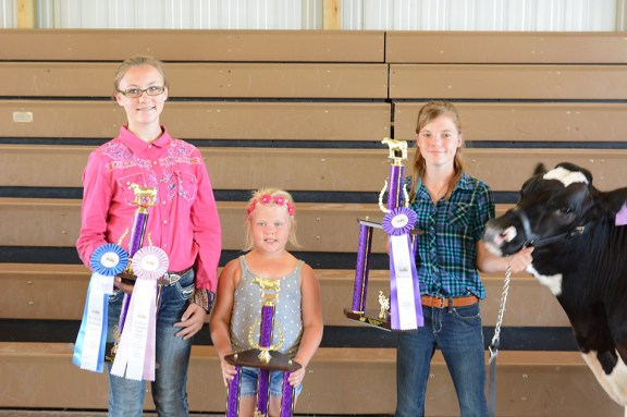 From left: Emily Robinson, reserve champion steer; Isabel Babbin, reserve champion dairy beef; Abigail Hays, grand dairy beef. Missing: Morgan Ahlfeld, grand steer.