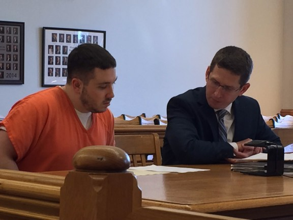Mykel Horsley with his attorney Chad Derouin.