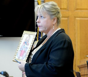 Prosecutor Donna Pendergast holds up a picture of Baby Kate.