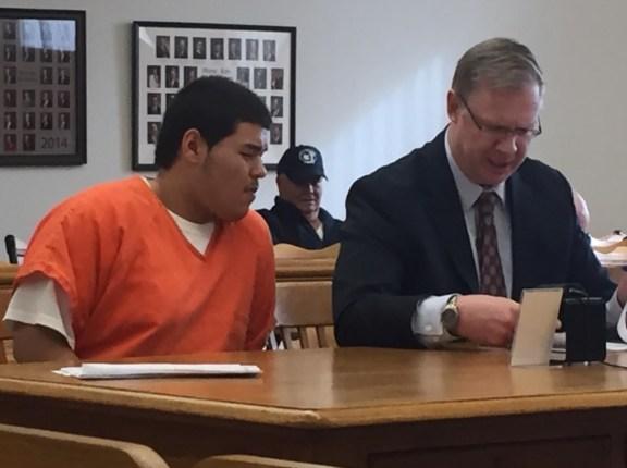 Isaiah Pena with his attorney, Ryan Glandville.