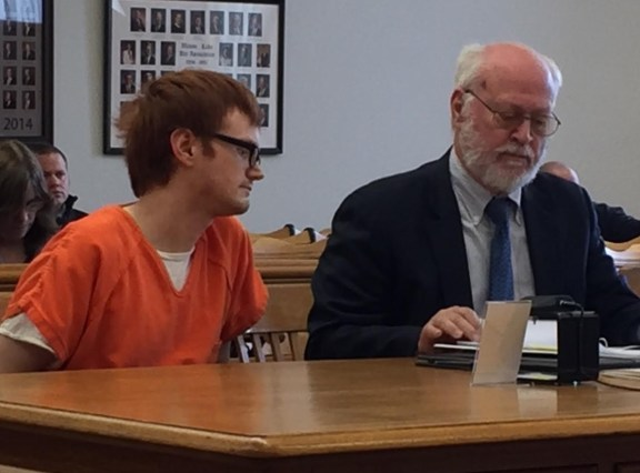 Jordan Bates with his attorney, Douglas Stevenson.