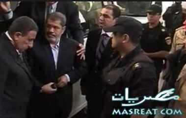احداث محاكمة الرئيس المخلوع مرسي ونقله الى السجن فيديو يوتيوب