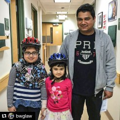 Children wearing bicycle helmets at the Windsor Street Care Center in Cambridge, Massachusets