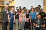 Graduates of the Girls in Action Program with Attorney David W. White. Breakstone, White & Gluck donated helmets for the program, which is led by Bikes Not Bombs.