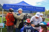 Framingham cyclist Bill Hanson helps Attorney David W. White out at the Project KidSafe tent. We fit more than 120 kids at Framingham Earth Day this year!
