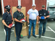 Attorney David W. White delivers our Project KidSafe helmets to the Everett Police Department in late June.