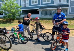 Everett Police giving away free bicycle helmets to local children from Breakstone, White & Gluck's Project KidSafe campaign