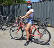 Photo courtesy: The Bike Connector - The Bike Connector gave away 20 refurbished bikes to Lowell students and their families on July 2nd. Breakstone, White & Gluck gave each cyclist a free bicycle helmet from our Project KidSafe campaign.