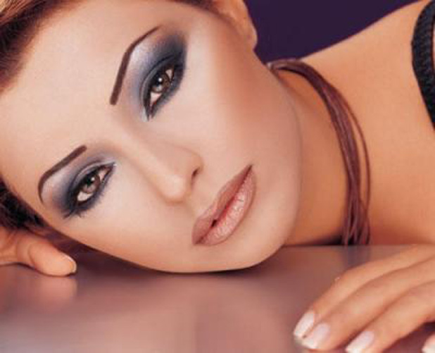 Brown eyes and hair with blue makeup