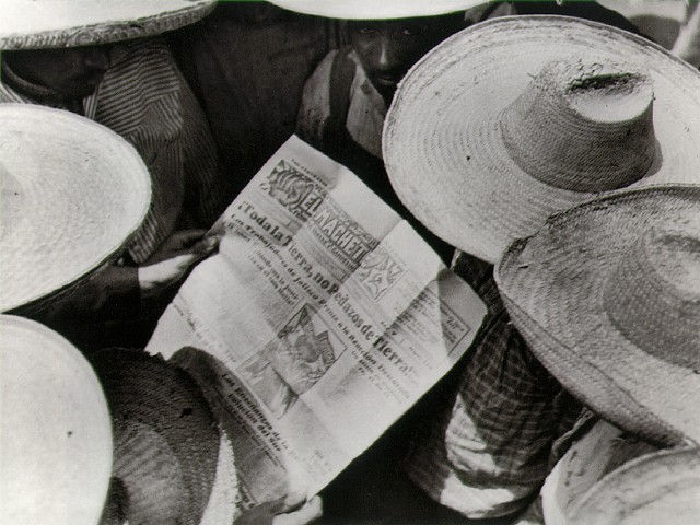 Mexican peasants reading El Machete (Tina Modotti)