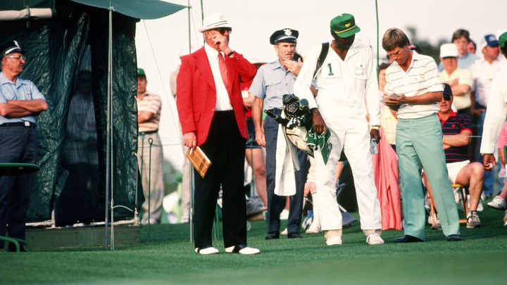 Ben Crenshaw studies his scorecard with his caddie before walking into the scoring tent at the 1984 Masters Tournament.