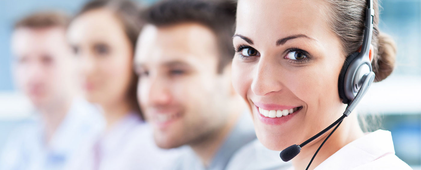 over-the-phone-interpreting-services-woman-headset-coworkers