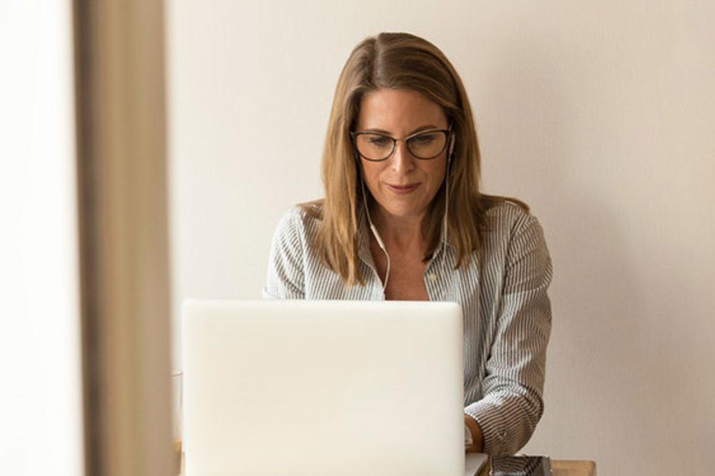 human-translation-services-woman-laptop-earphone-assessments