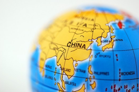 Macro shot of a toy globe showing China