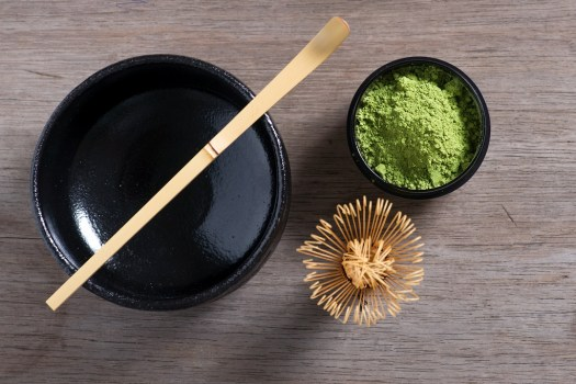 Japanese tea ceremony setting on old wooden bench. Studio photo. Green tea utensils. From top.