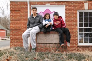 My brother, sister and I posing in front of Adrales Medical Building