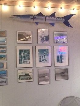 Surfing pictures and newspaper articles cover the walls.