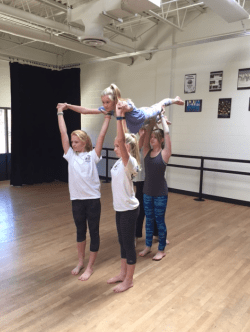 Dancers working on a lift.