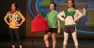 """Woody, Andy, and Buzz from """"Toy Story"""" proudly carry the senior girls' presents"""