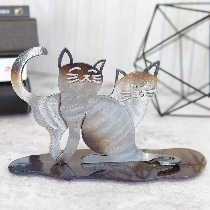 Escultura de gatinhos em metal