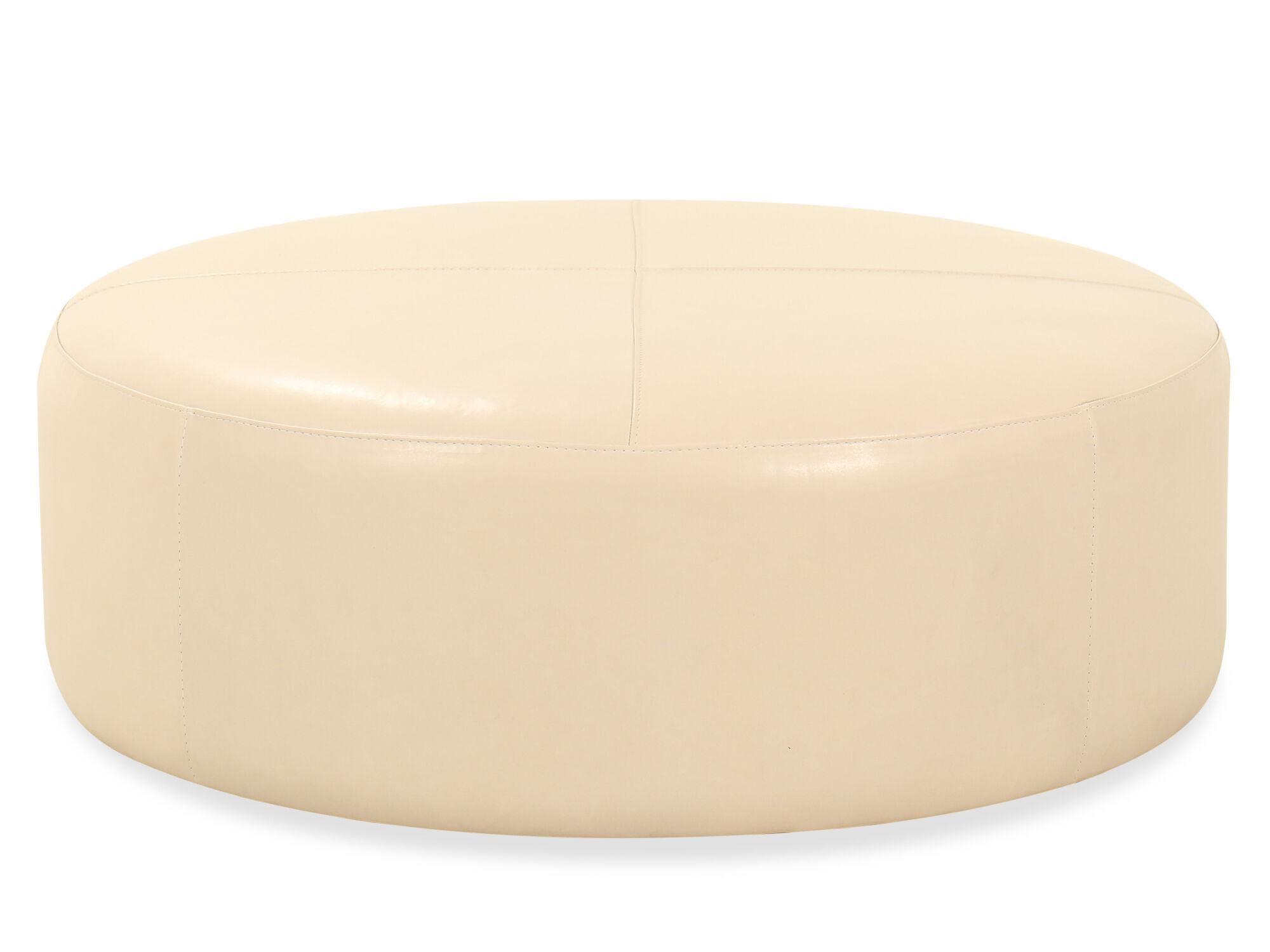 round leather 42 ottoman in cream