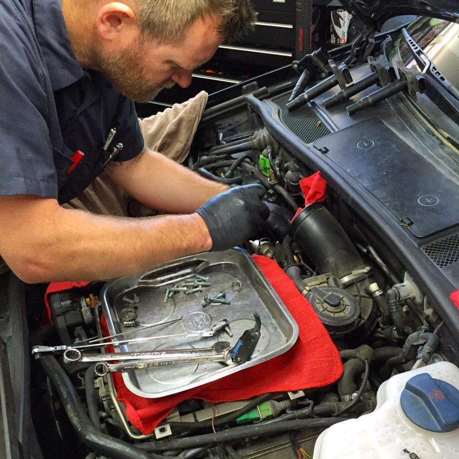 VW expert repairing camshaft chain tensioner gasket leak