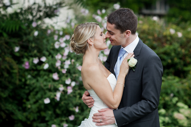 mat-smith-photography-bride-groom-kiss-blossom