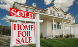 Home For Sale Sign in Front of Beautiful New Home