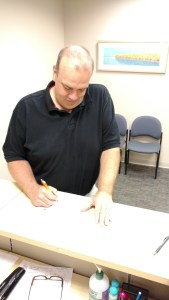 Matt signing the official candidate registration form.