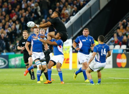 New Zealand's Centre Malakai Fekitoa fumbles the ball mid air. Rugby World Cup group game from Pool C between New Zealand and Namibia at Olympic Stadium. (c) Matt Bristow