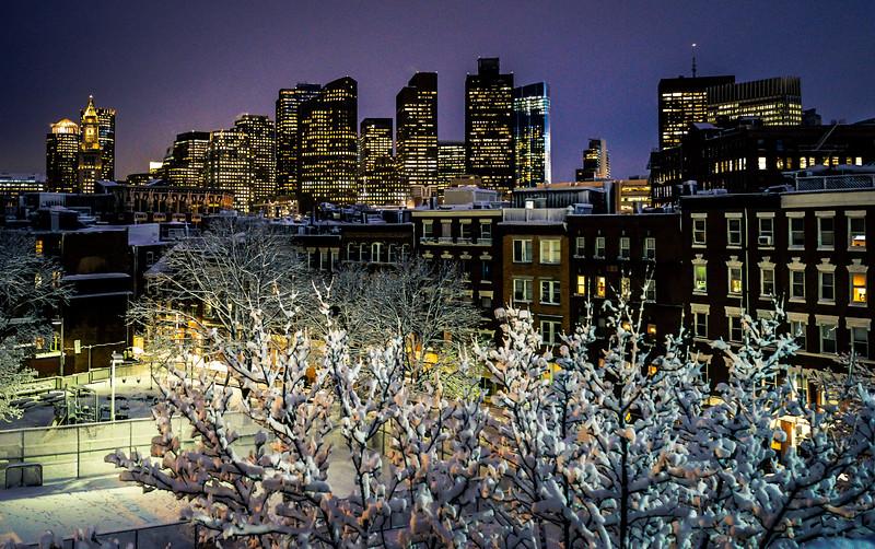 Snow covered DeFilippo Playground (Gassy) with Boston Skyline