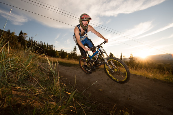 Mountain biker riding the trail and jumping in beautiful sunrise light.