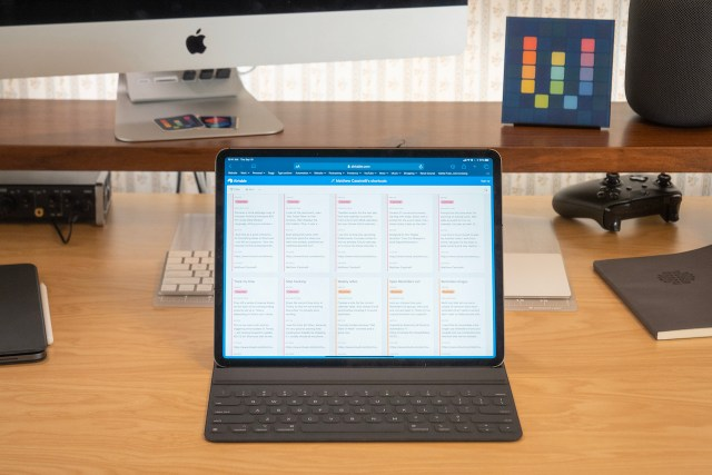 Photograph of Matthew Cassinelli's Shortcuts Library open on his iPad on his desk.