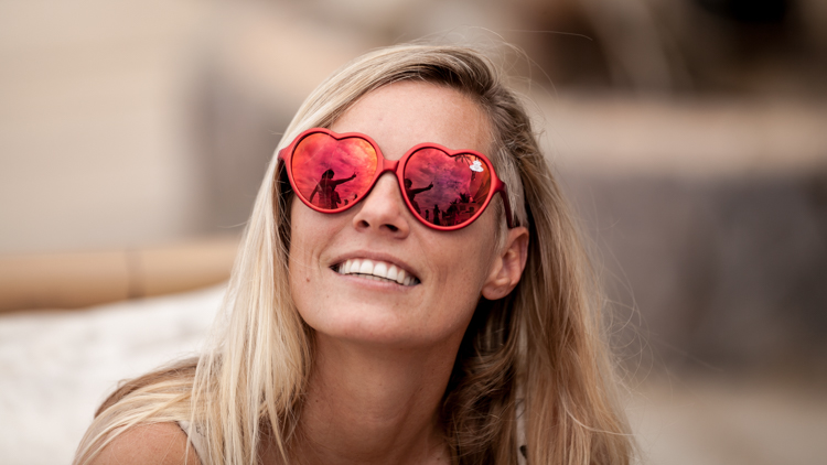 Portrait of Susi Mai wearing red robot heart sunglasses